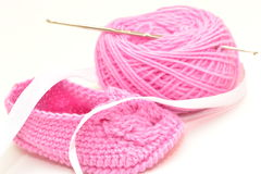 Baby knitted booties. Royalty Free Stock Photos