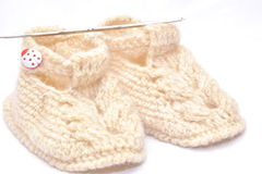 Baby knitted booties. Stock Photos