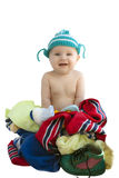 The baby in a knitted cap sits Stock Image