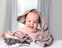 Baby with knitted clothes.Warming up clothing. Stock Images