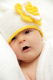 Baby with a knitted hat Stock Image