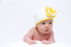Baby with a knitted hat Stock Images