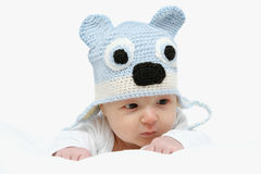 Baby with a knitted hat Stock Photography