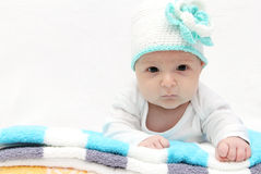 Baby with a knitted hat Stock Photos