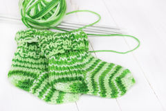 Baby knitting socks Stock Photo