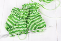 Baby knitting socks Stock Photos