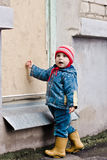 Baby knocks on the window. Royalty Free Stock Photos