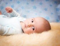 Baby on lamb wool Royalty Free Stock Photo