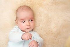 Baby on lamb wool Royalty Free Stock Image