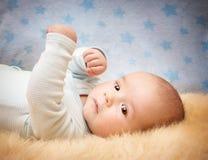 Baby on lamb wool Royalty Free Stock Photos