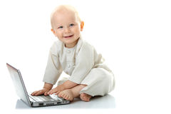 Baby with laptop Royalty Free Stock Photo