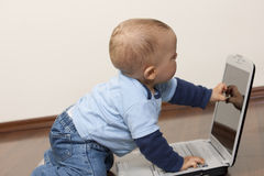 Baby with laptop Stock Photos