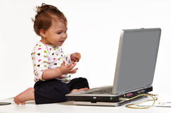 Baby and laptop Stock Photo