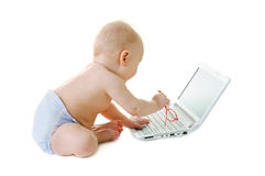 Baby with a laptop Stock Photo