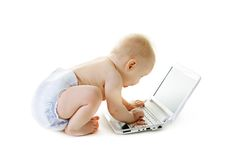 Baby with a laptop Stock Images