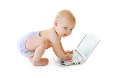 Baby with a laptop Royalty Free Stock Image