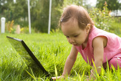 Baby with laptop Stock Images