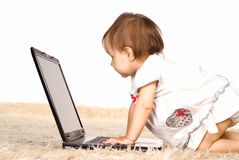 Baby and laptop Stock Photography
