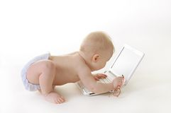 Baby with a laptop Royalty Free Stock Photo