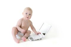Baby with a laptop Stock Photography