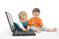 Baby and laptop Royalty Free Stock Photography