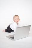 Baby with laptop. Baby girl on white background Royalty Free Stock Photos