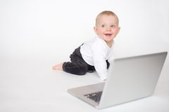 Baby with laptop. Baby girl on white background Royalty Free Stock Photo