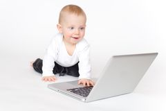 Baby with laptop Stock Photo