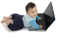 Baby with Laptop. 9 month-old baby makes itself close with the laptop Royalty Free Stock Photos