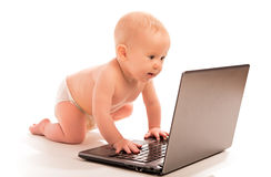 Baby and a laptop computer isolated Stock Image