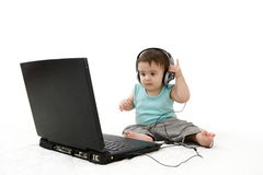Baby laptop and headset Stock Images