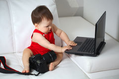 Baby and laptop Royalty Free Stock Photos