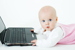 Baby with laptop in studio Royalty Free Stock Image