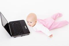 Baby with laptop. studio photo Stock Image
