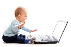 Baby and laptop royalty free stock photo