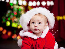 Baby in large Christmas hat Stock Image
