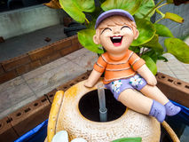 Baby laugh on jar in front of shop Royalty Free Stock Photos