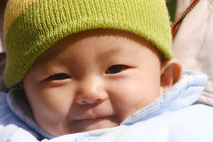 Baby laughing. Cute baby in pink blanket laughing happily Royalty Free Stock Photography