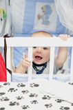 Baby laughing. Baby boy laughing and playing in his crib royalty free stock photo