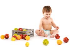 Baby with fruit stock photos