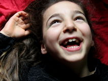 Girl happy. Baby laughing happy and looks up Stock Photography
