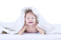 Baby laughing inside blanket - isolated Royalty Free Stock Photography