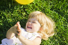 Baby laughs Stock Image