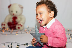 Baby laughs. Royalty Free Stock Photo