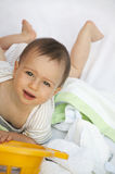 Baby and laundry Royalty Free Stock Image