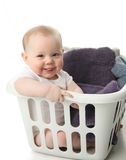 Baby in a laundry basket Royalty Free Stock Photos