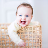 Baby in a laundry basket Stock Photography