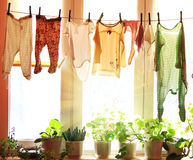 Baby laundry hanging on a clothesline Stock Images