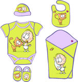 Baby Layette with cute baby and cat -  Royalty Free Stock Images