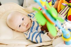 Baby laying in bouncer chair stock photography